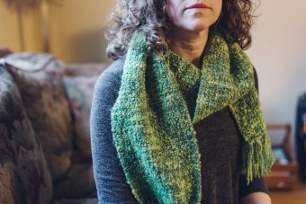 Laura Alary wears the scarf that helped spark her gratefulness.