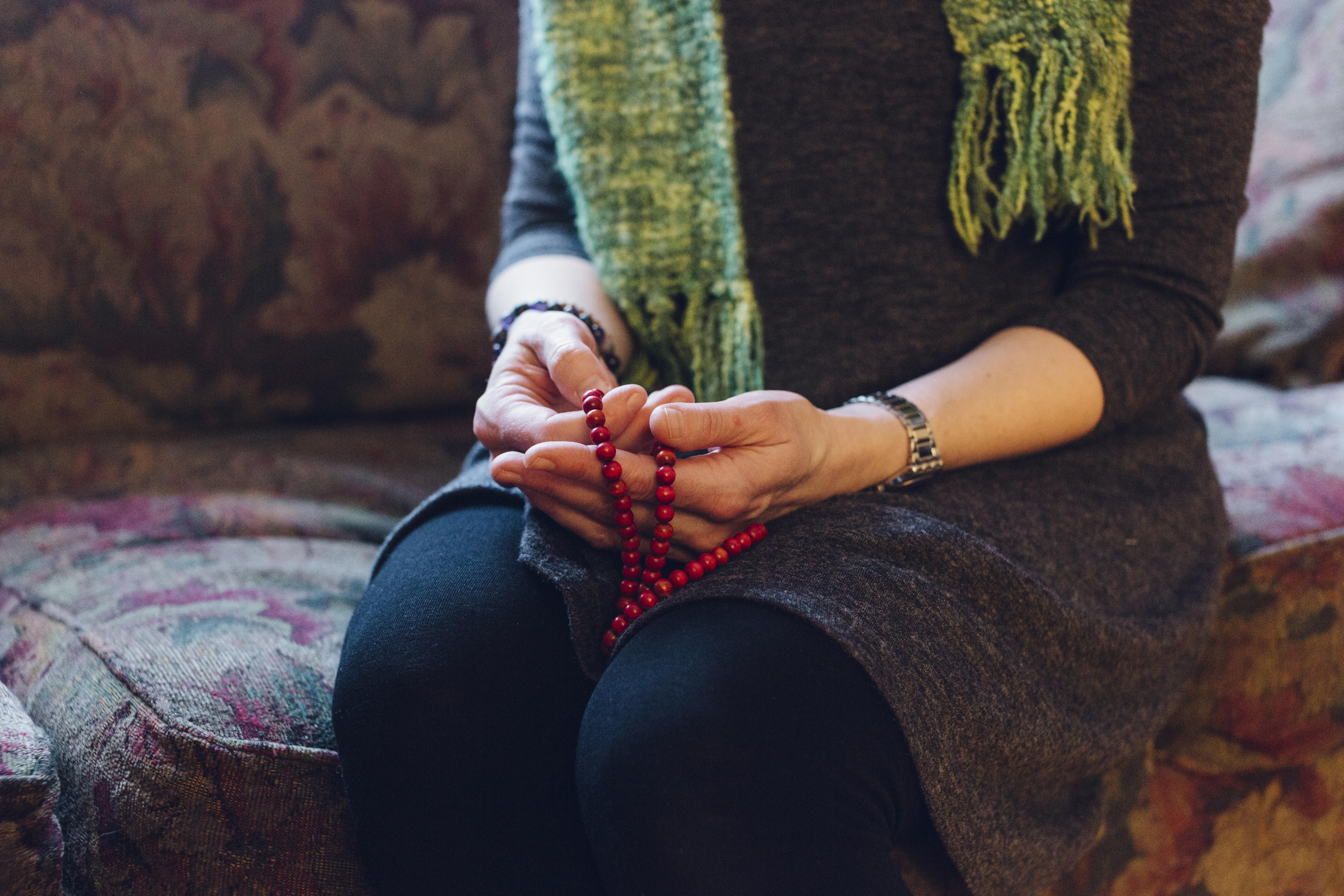 Laura Alary holds a mala as she thinks about the specific things she's grateful for in her life