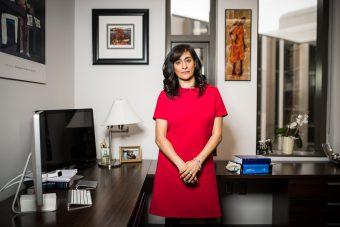 Anita Anand standing beside her office desk