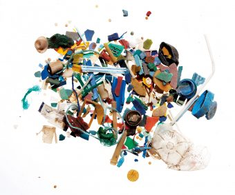 A pile of many different teeny tiny pieces of plastic in a variety of colours, including pieces of straws, plastic water bottle lids.