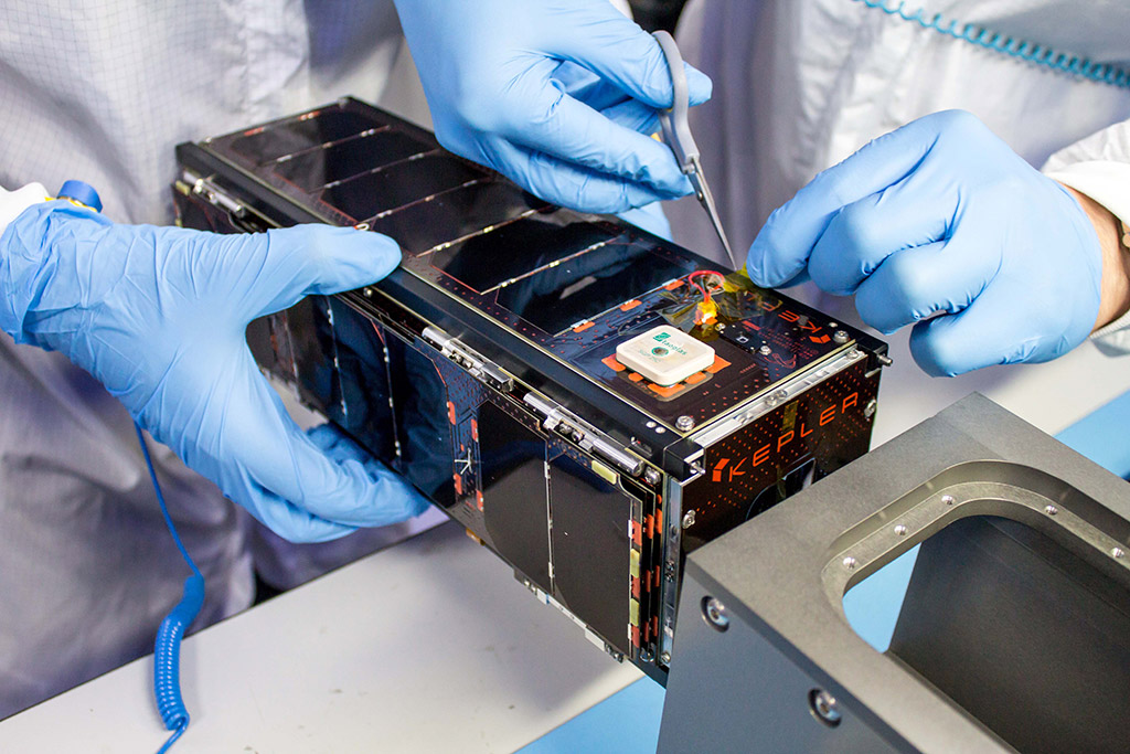 Closeup of Kepler satellite being worked on by researchers