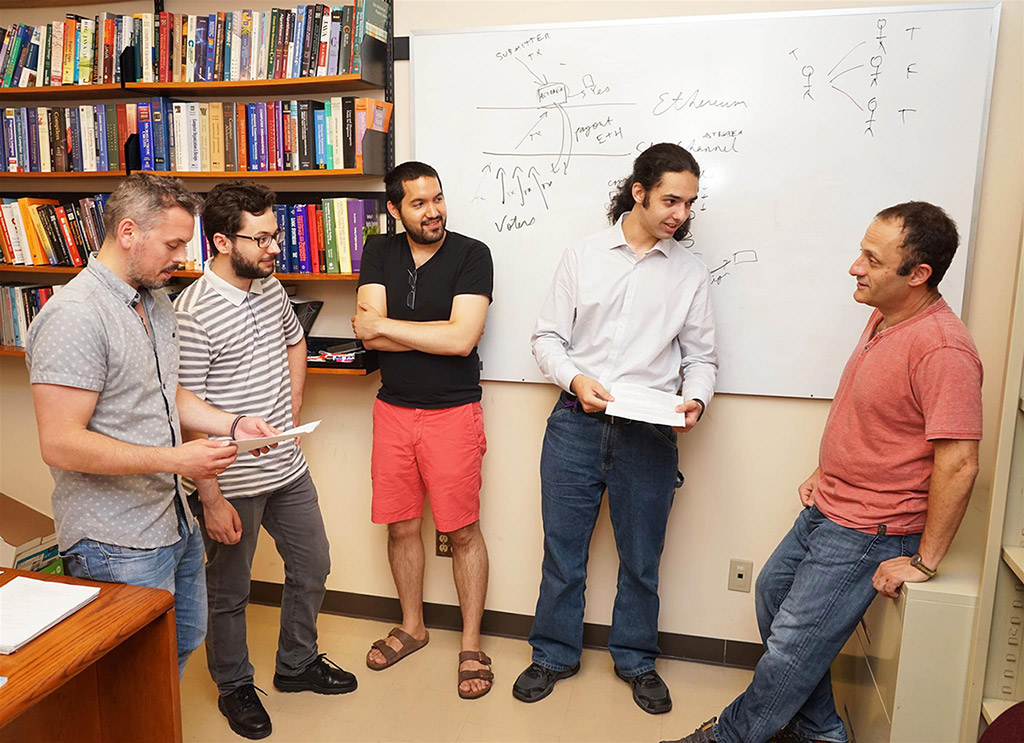 Andreas Veneris and his team in a discussion