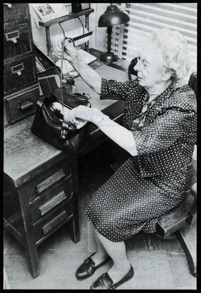 Dr. Elizabeth Bagshaw sits at a desk and packs her medical bag to go on house calls.