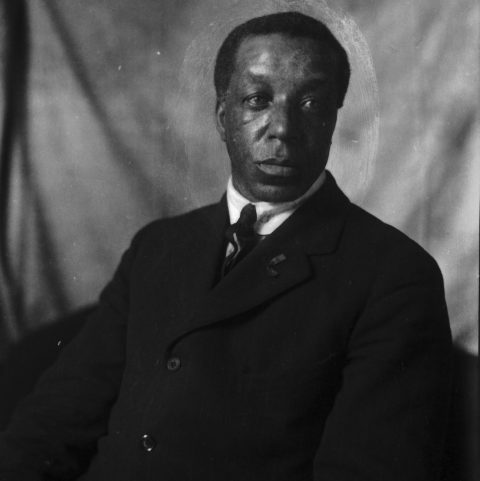 A black and white portrait of William (Billy) Beal, a Black settler who arrived in Swan Lake, Manitoba in 1906.