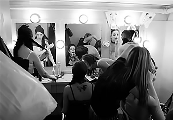 Cast members of The Rocky Horror Show in a dressing room preparing for a midnight performance at Hart House