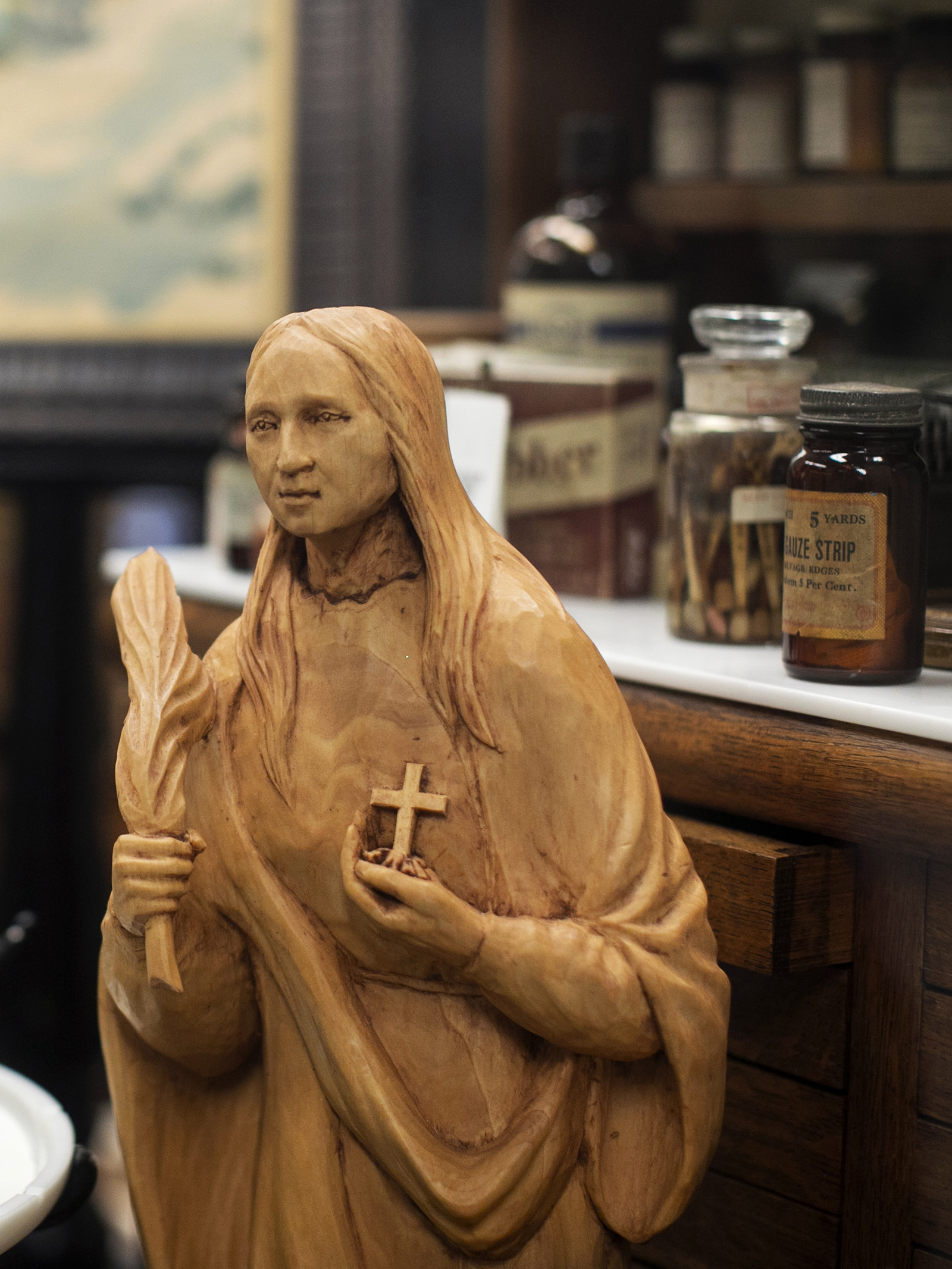 Wood carving of the patron saint of dentistry