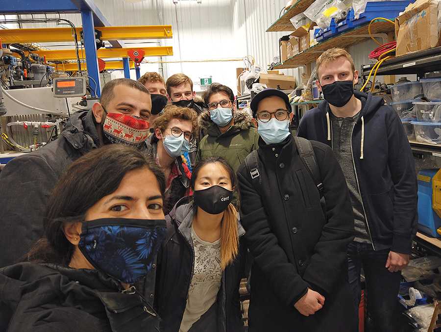 Group photo of nine members of U of T's Carbon XPrize team wearing masks