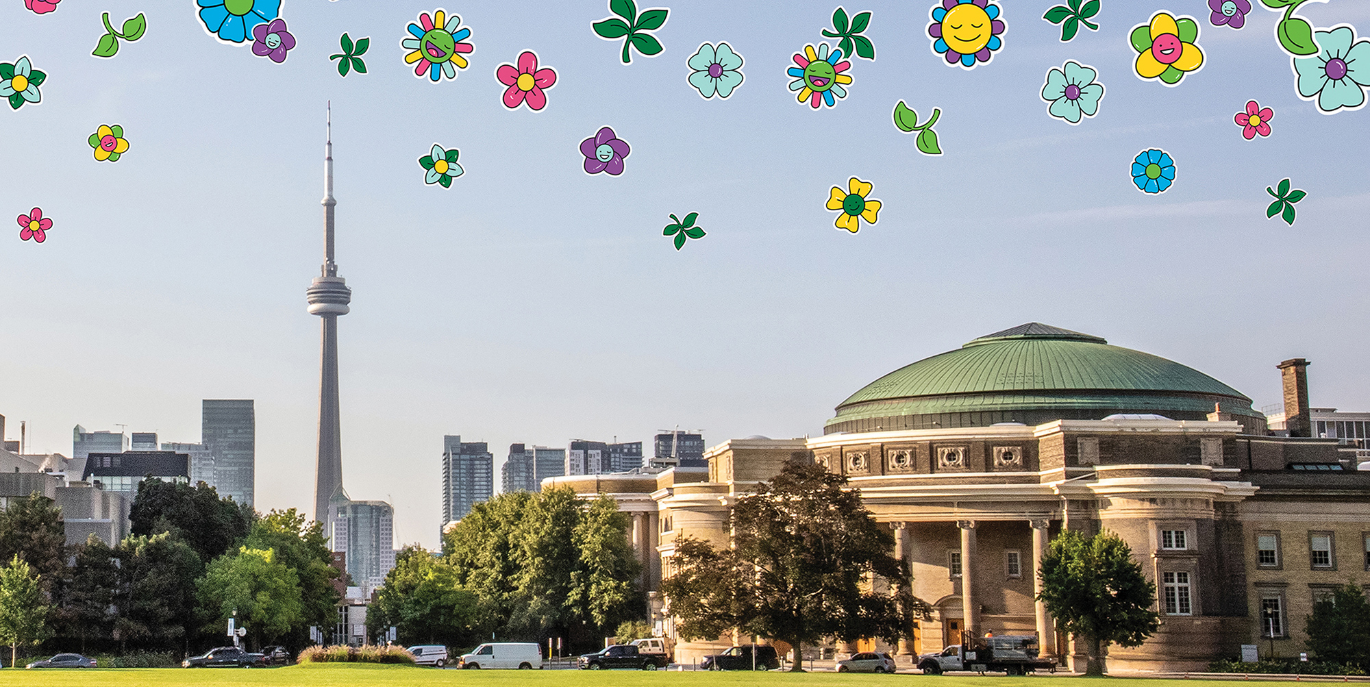 Photo of front campus field and Convocation Hall with flower emoji illustrations floating above