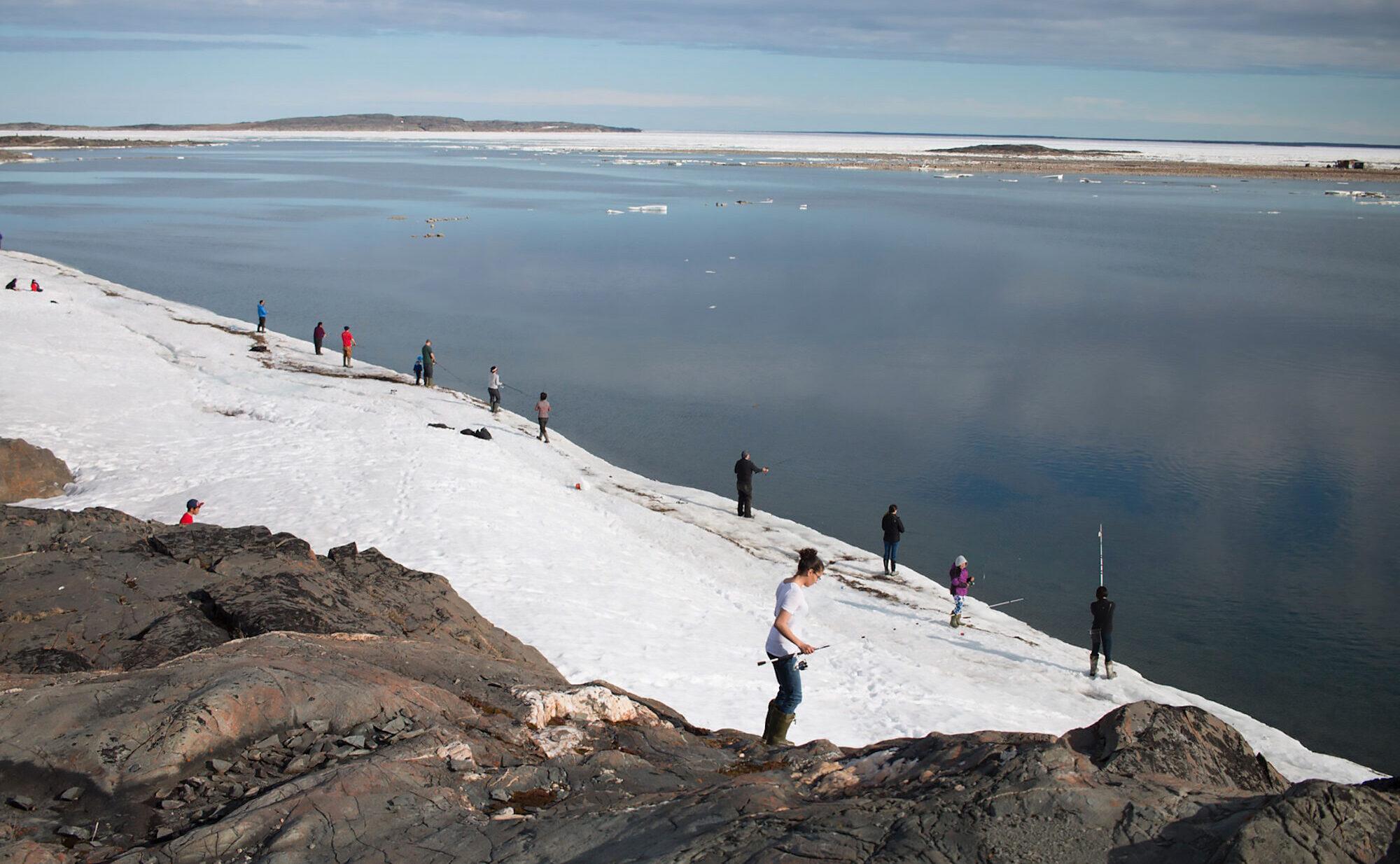 People fishing along the shoreline